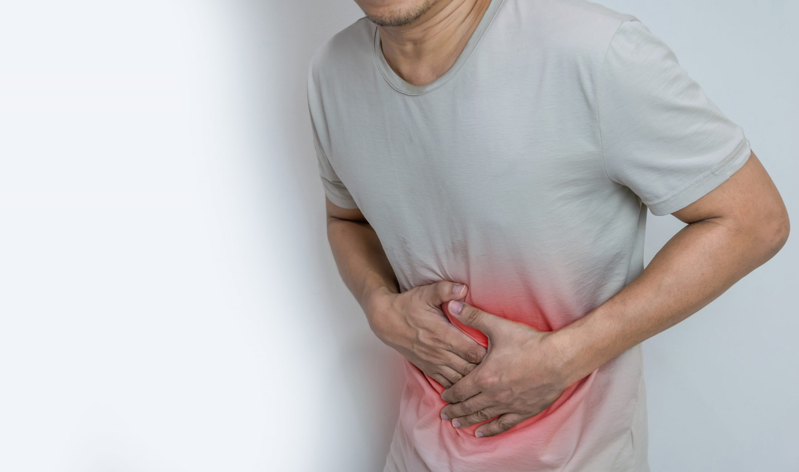 man-suffering-from-stomach-ache-with-both-palm-around-waistline-to-show-pain-and-injury-on-belly-area